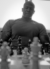 DANILOVGRAD, Montenegro - Staff Sgt. Chris Stevens, a personnel retrieval and processing specialist with Detachment PRP Smyrna, Ga., contemplates his next move while playing Montenegrin chess great, Bozidar Ivanovic aboard the Danilovgrad Training Base in central Montenegro. The men played their game during the sports day of Medical Training Exercise in Central and Eastern Europe 2010. The exercise brings together nearly 300 service members from the armed forces of the U.S. and nine central and eastern European countries together for mass casualty scenario response training. (Official Marine Corps photo by Lance Cpl. Jad Sleiman