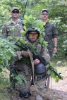 UKRPhoto06YAVORIV, Ukraine – Cpl. Colt Smith, a paratrooper with the 173 Airborne Regiment, and a Ukrainian translator stand behind a guardsman undergoing training during a simulatedpatrol July 9 at a training facility in western Ukraine. About300 American paratroopers have been training Ukrainian soldiers forthe fight against Russian-backed separatists in eastern Ukraine sinceApril.Jad Sleiman / Stars and Stripes